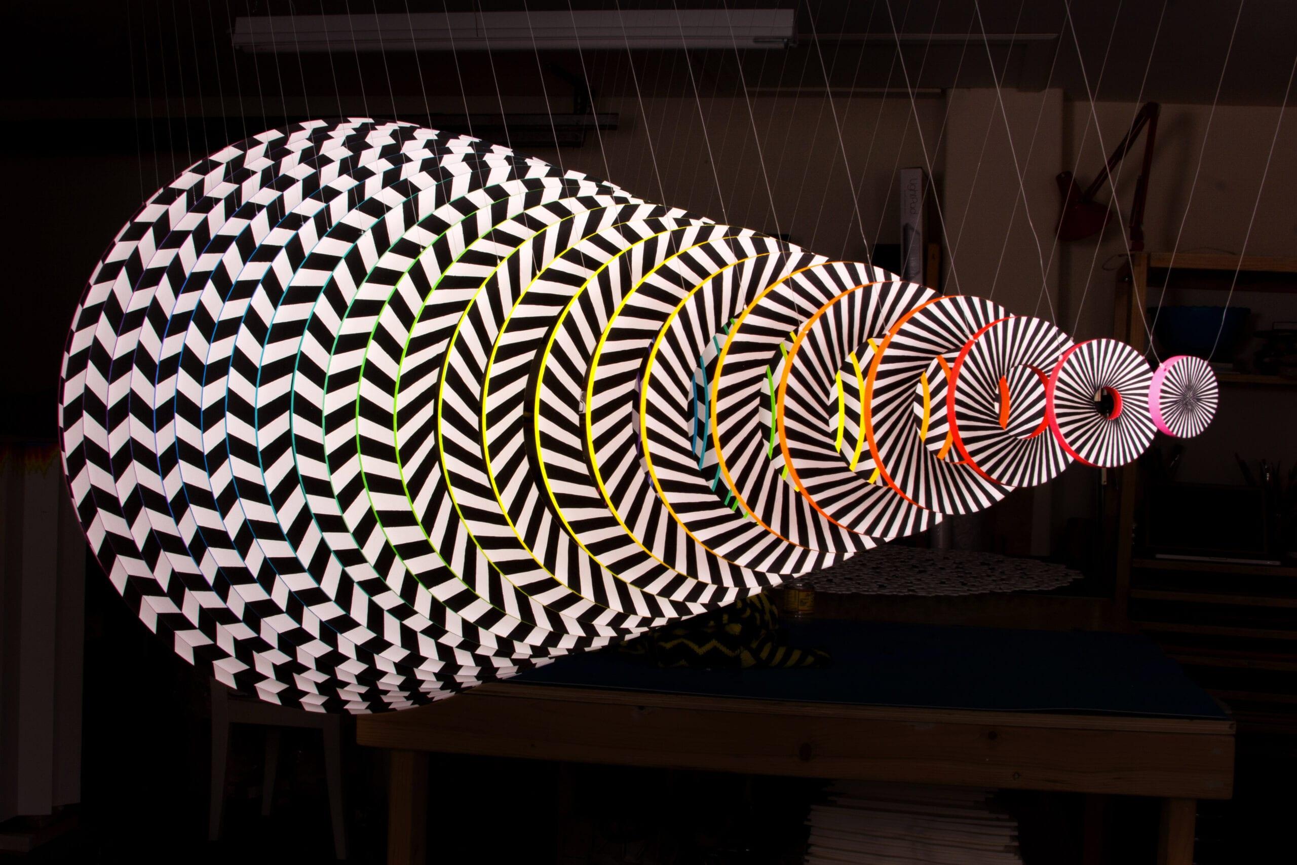 "Jen Stark, Dimension (Back), PVC, acrylic paint, UV varnish, monofilament, 25""x 25""x 50"", 2013."