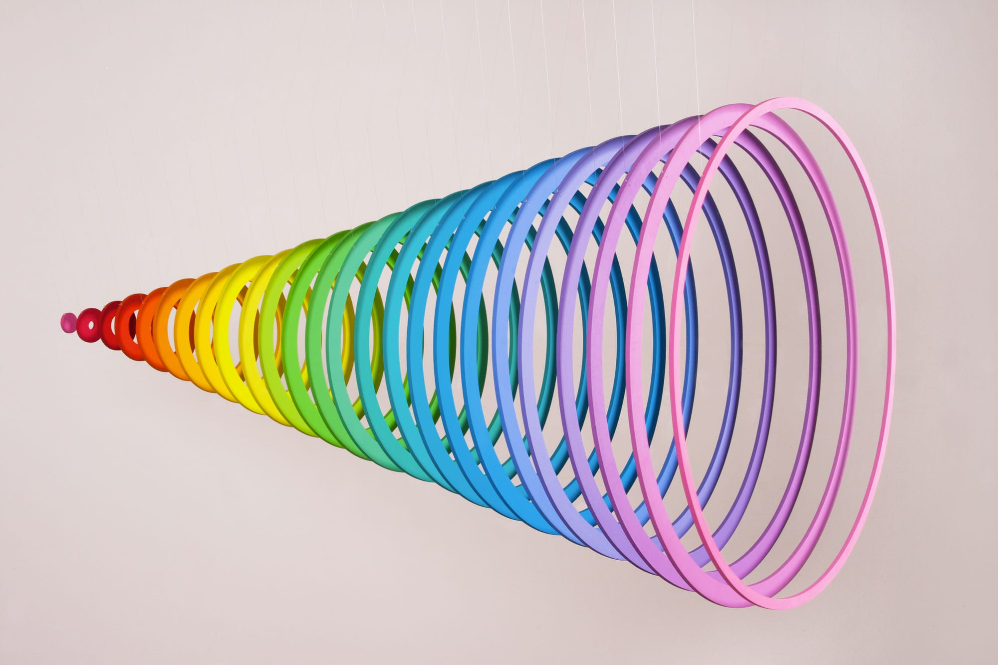 "Jen Stark, Dimension (Front), PVC, acrylic paint, UV varnish, monofilament, 25""x 25""x 50"", 2013."