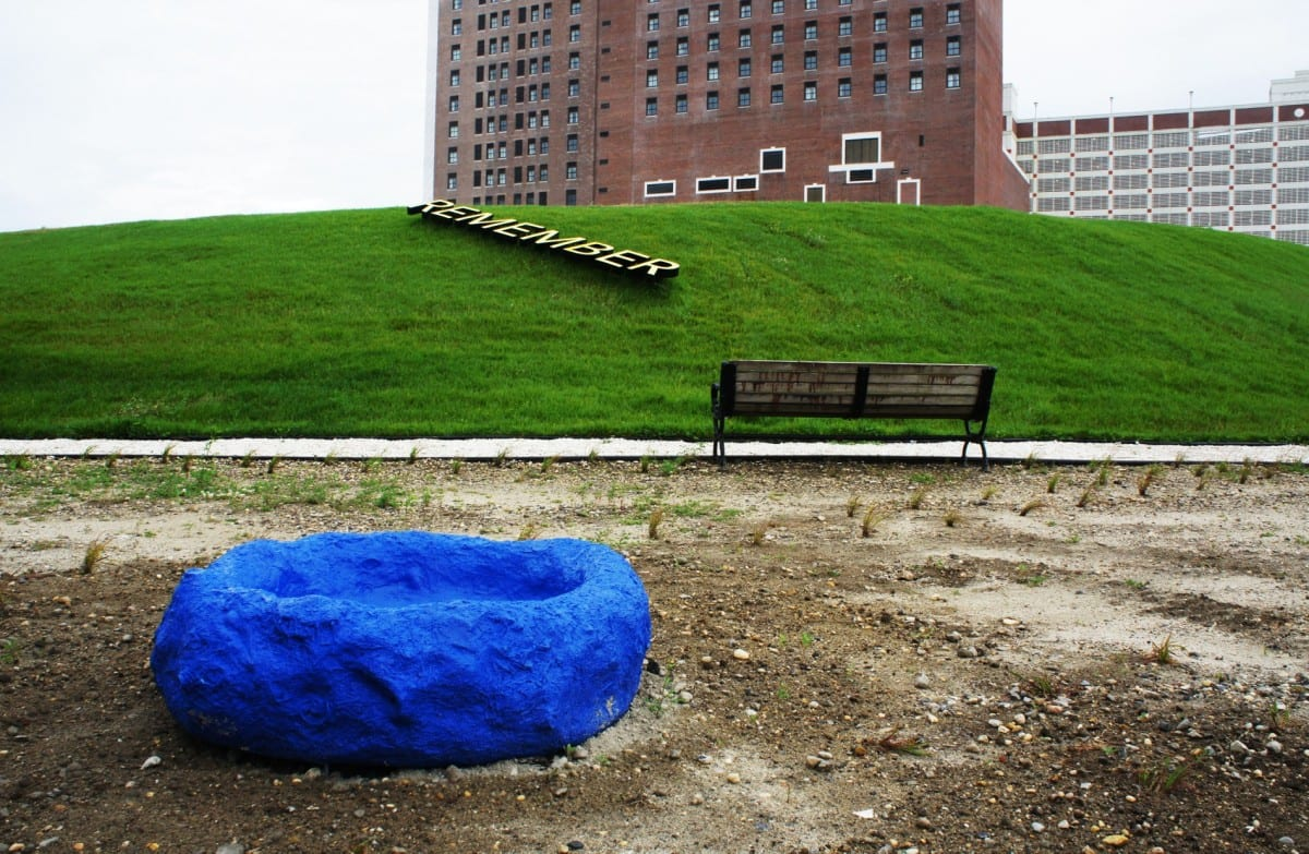Robert Lach's Refuge Nest Colony consisting of brightly colored Fiberglass Reinforced Polyester nests in front of Robert Barry's text installation embedded in the earthen mounds. Photograph by Layman Lee. Image courtesy of Fung Collaboratives.