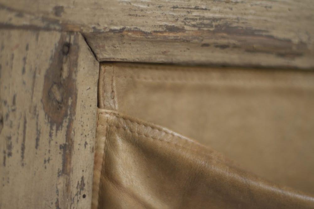 Indoor Door Table Detail of Cowhide Pocket courtesy of Manoteca