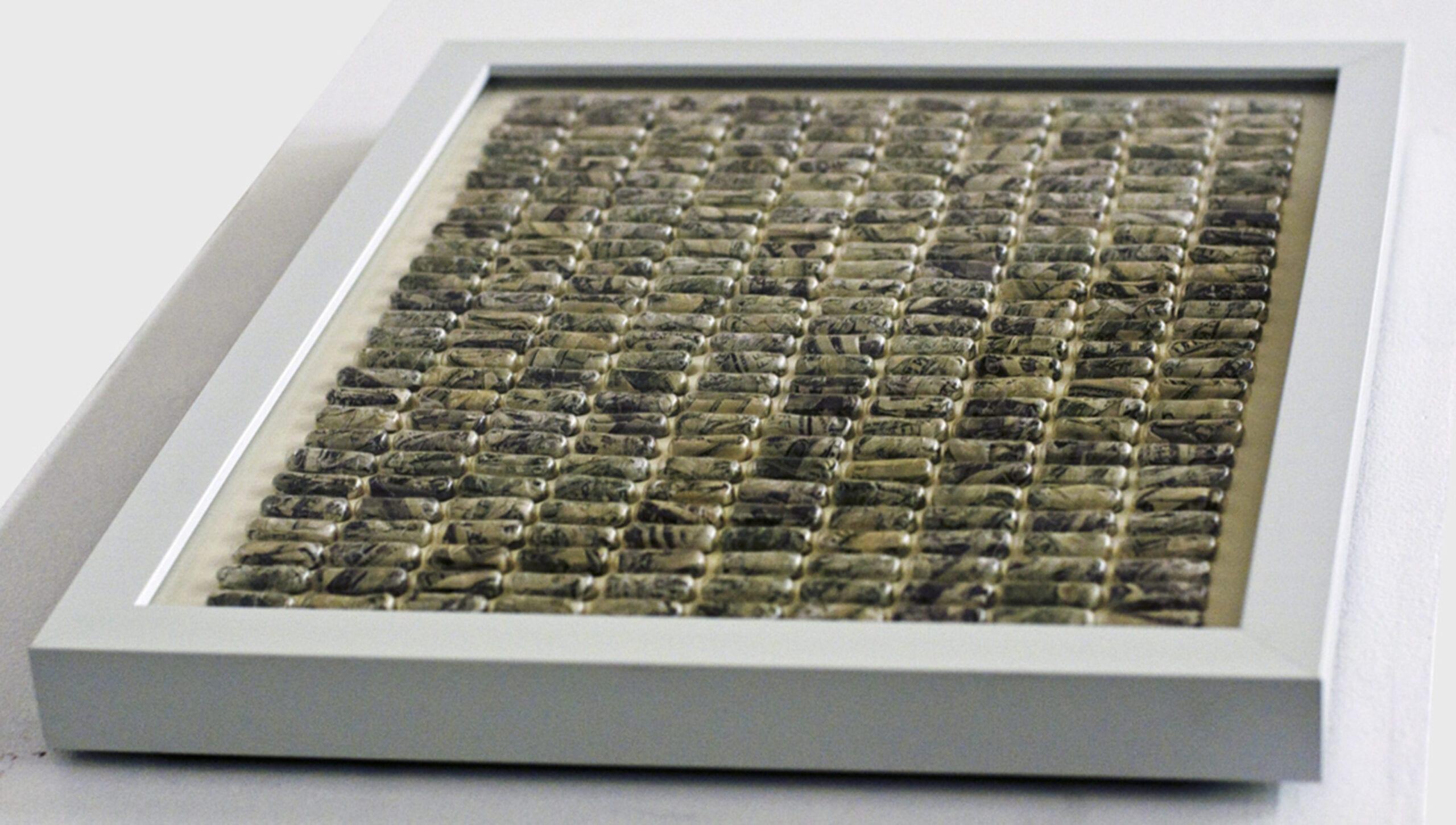 Jason Guo, One-Year American, Empty gelatin 00 capsules, 100-dollar bills, MDF, steel, acrylic, UV glass, 30 x 30 x 3 cm, 2011