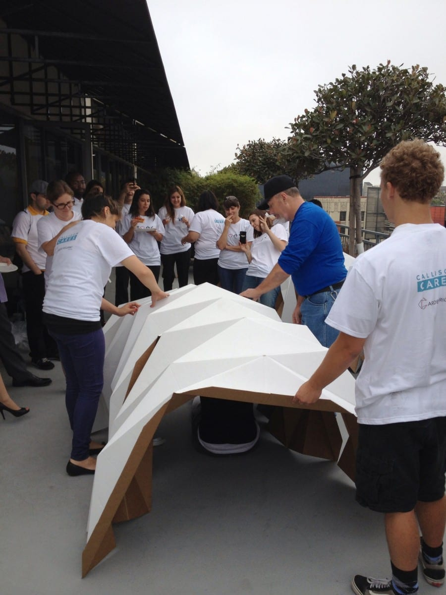 The Callison Cares team in the midst of constructing a Cardborigami cardboard shelter.  © 2013 Callison LLC