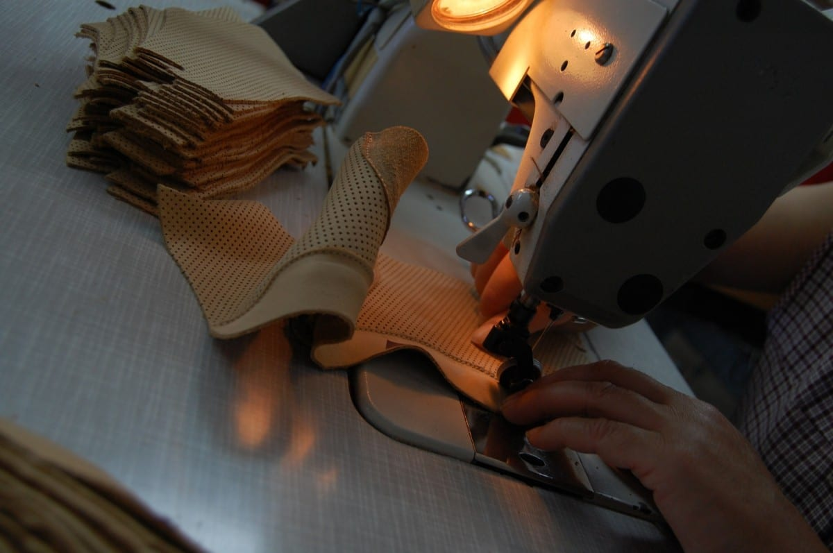 Stitching the perforated calfskin lining for the boot © ATHEIST
