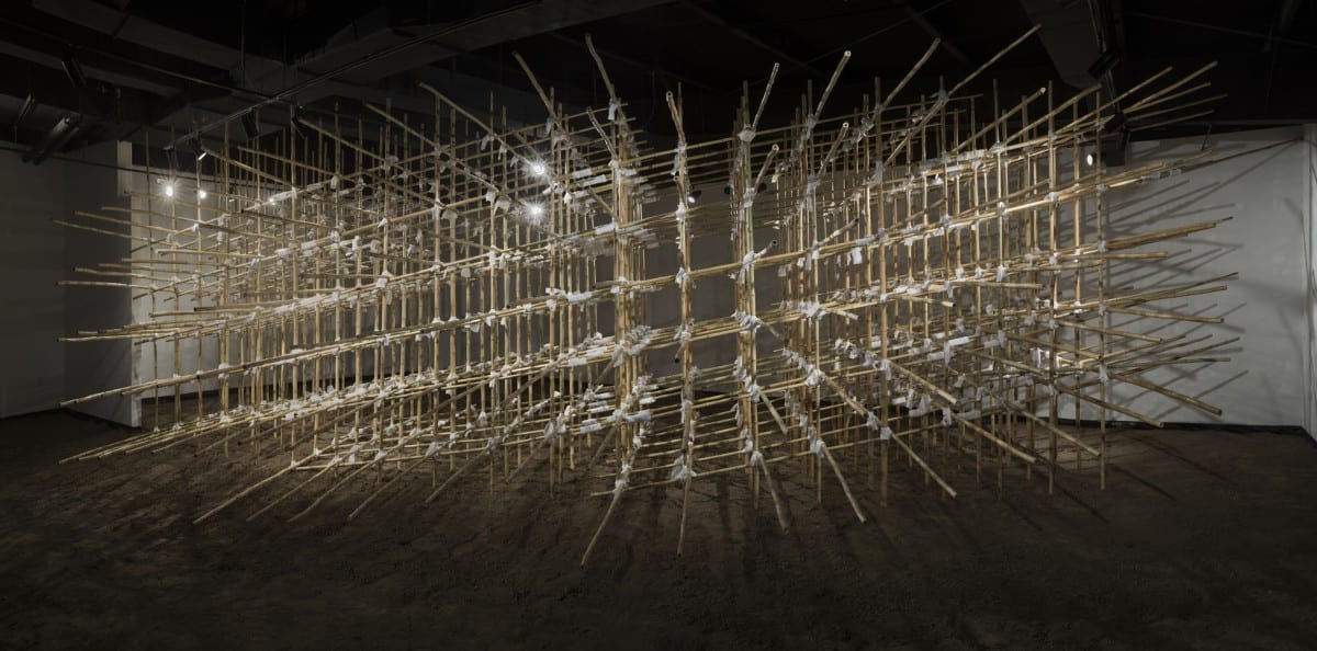 Sarah Frost, Site, bamboo poles, household linens, dirt, 42' x 15' x 10'