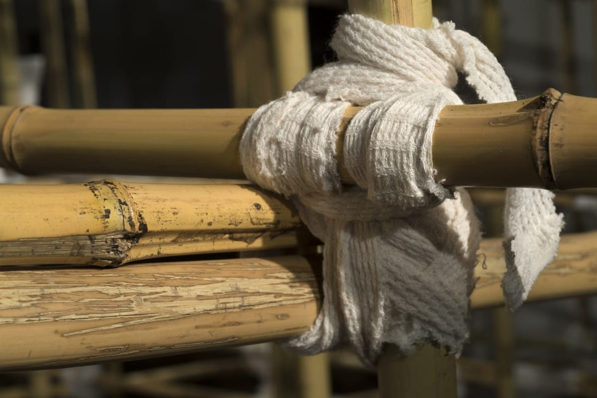 Sarah Frost, Site (detail), bamboo poles, household linens, dirt, 42' x 15' x 10'