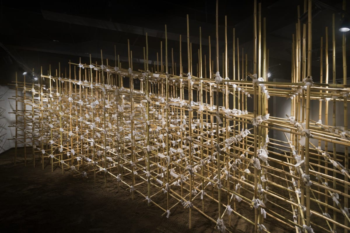 Sarah Frost, Site (interior), bamboo poles, household linens, dirt, 42' x 15' x 10'