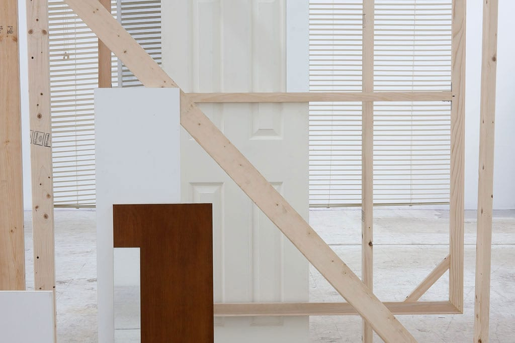 Leyden Rodriguez- Casanova, A Corner Structure Assemblage (detail), wood, vinyl, MDF, vinyl blinds, hollow core door, steel, mirror, Dimensions variable, 2014