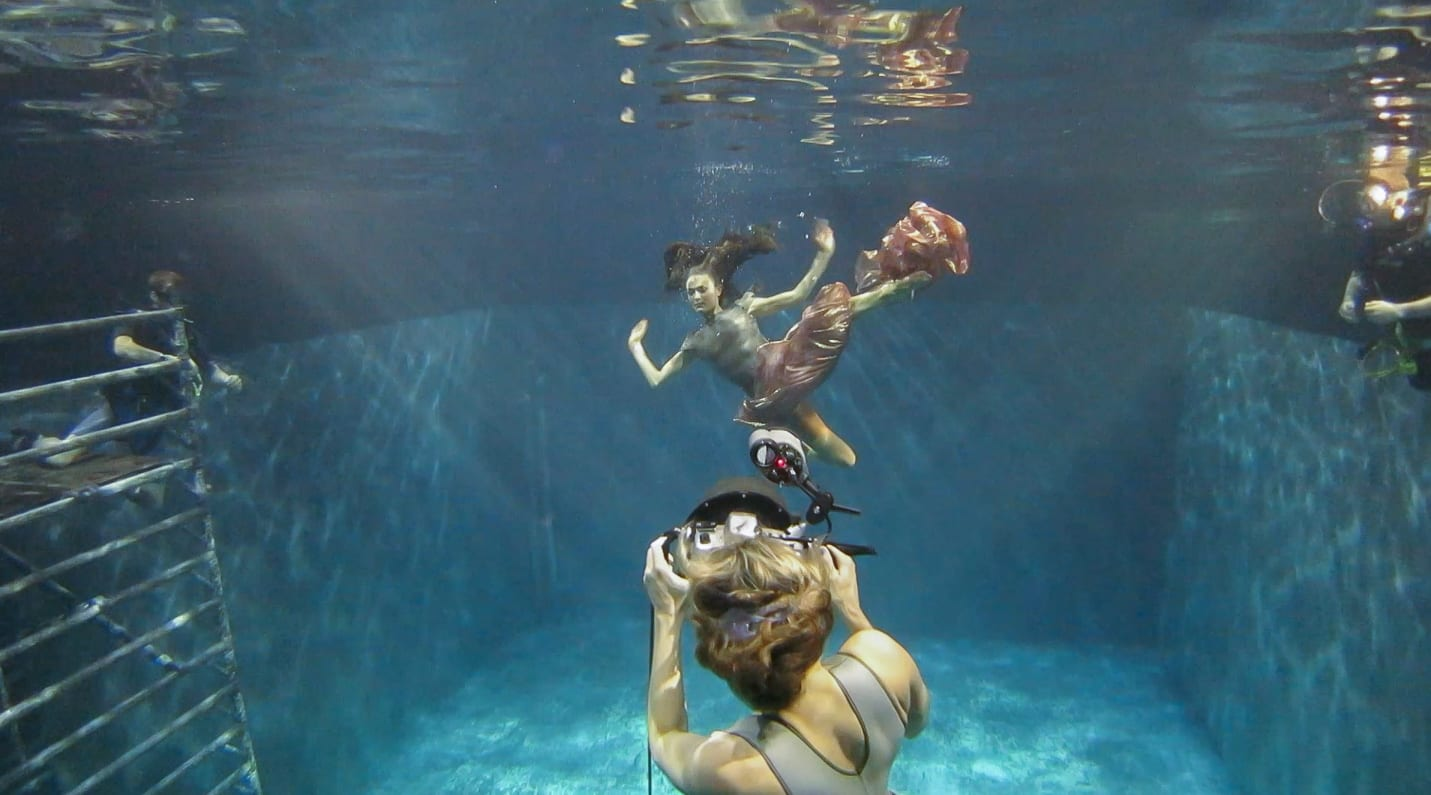 Shooting underwater with two safety divers on each side of the model. Photo by Peter Maia-Tanner. © Maya Almeida