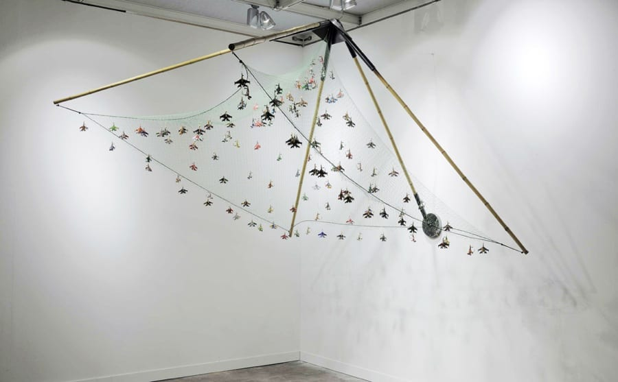 Mircea Cantor, Fishing Flies, airplanes made from soda cans, fish hooks, fishing net, fishing wire, bamboo, steel, 170 x 270 x 270 cm, 2011.  Courtesy of the artist and Magazzino, Rome