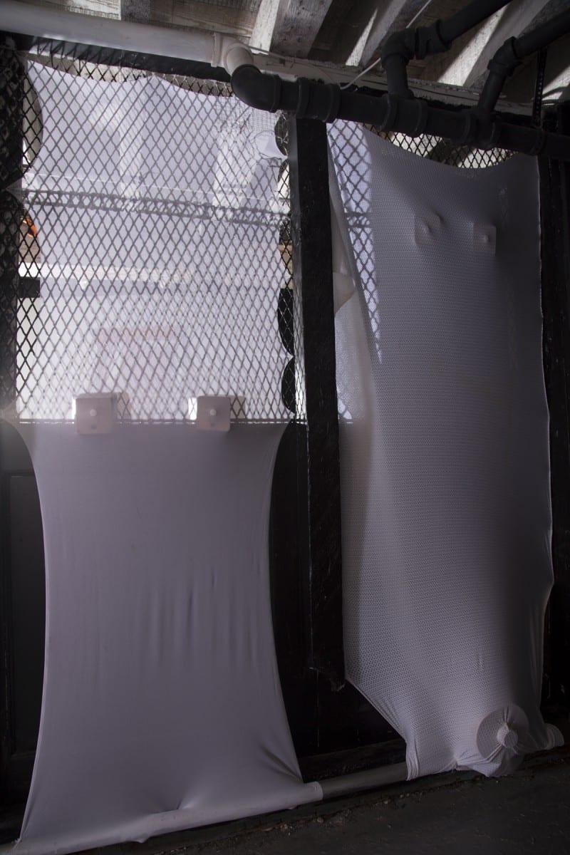 "Leeza Meksin, Leg Fairings, Site-specific Installation. Athletic Mesh, wood, thigh form dummy, staples. 77"" x 69"" x 7"", 2014."