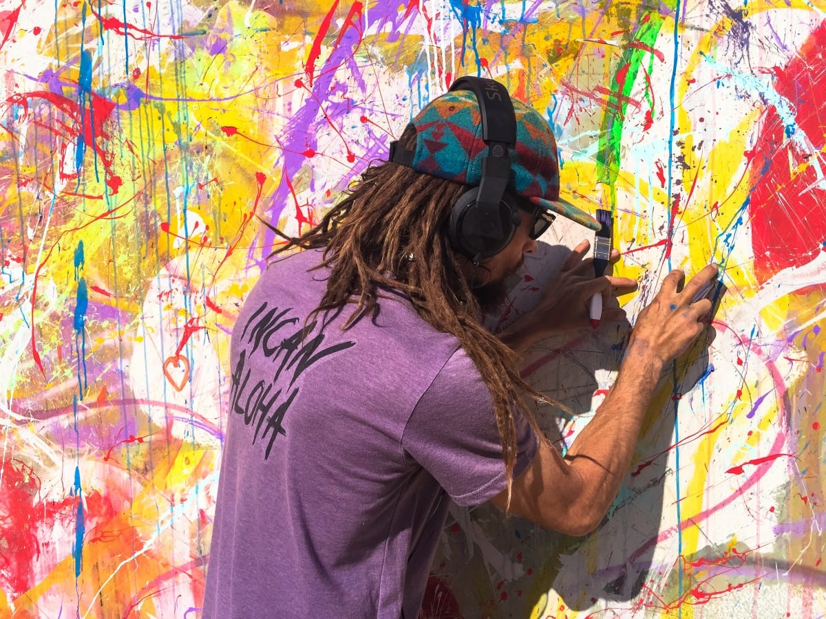 "Jared Aufrichtig painting his ""Motus Nunc et Hie - Colores De Peru"" mural in Peru 2015. Photo Angelika Sauer"