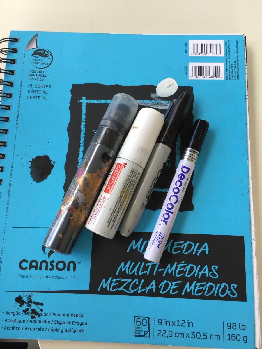 Notebook and drawing instruments.